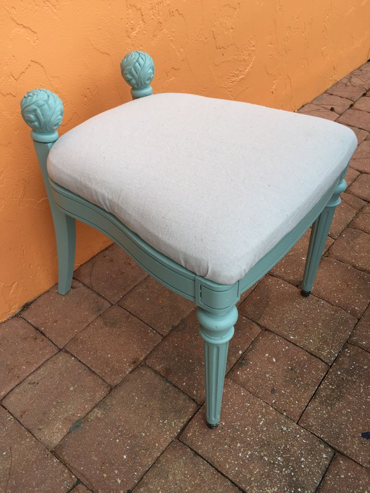 Rescued and repurposed chair with broken cane back into vanity bench or luggage rack; cut off the back; add two carved finials rescued from discarded curtain rod; recover seat cushion in painters drop cloth canvas; an original design and photo by Estate ReSale & ReDesign.  Sold for $48.  Upcycle, Recycle, Salvage, diy, thrift, flea, repurpose, refashion!  For vintage ideas and goods shop at Estate ReSale & ReDesign, Bonita Springs, FL