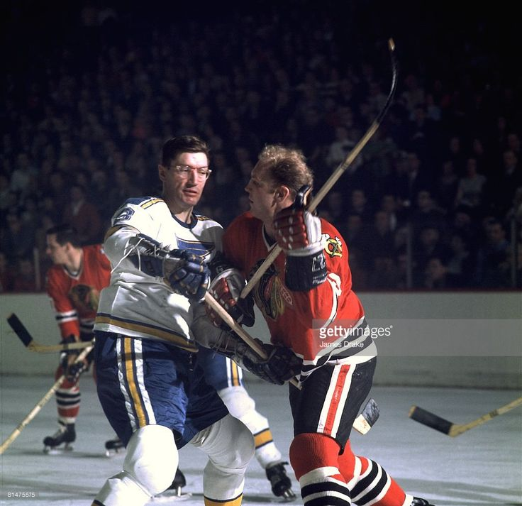Chicago Blackhawks Bobby Hull (9) in action vs St, Louis Blues Al Arbour (8), Chicago, IL 1/15/1968