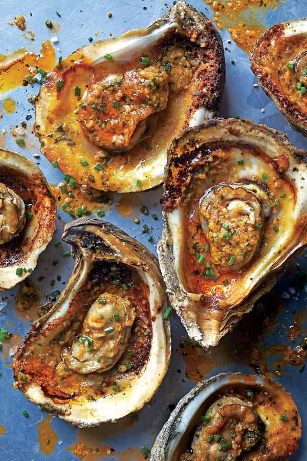 """Grilled Oysters Recipe!!! So delicious!!!! LOVE the flavors!! Description... """"The secret to this dish, a chargrilled homage to Gulf oyster houses, is a knockout garlic-herb butter."""" So easy to make too!! #oysters #appetizer #seafood"""