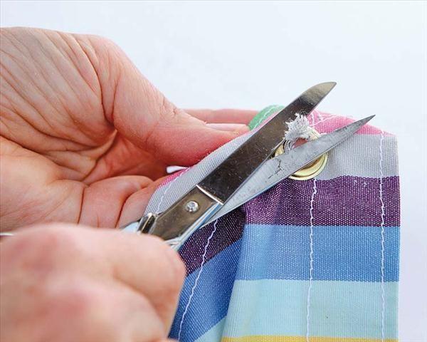 diy garden ideas sewing shade cloth cut excess fabric eyelets