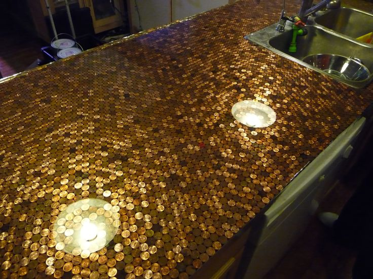 We used two part clear epoxy and a bunch of coins to make a penny countertop that has held up remarkably well under all kinds of abuse.