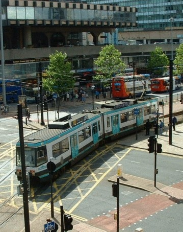 MANCHESTER   The Victorian tram rails were all removed when I was a child.  Now there are trams in Manchester once again.