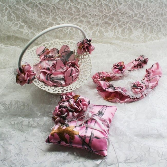 This pink camo wedding accessory combo package is a great way to save money. You get a cute little crocheted flower girl basket, 100 petals to go in the basket, a ring bearer's pillow, and a garter set. All are decorated with satin camo roses and eyelash behind them for a bit of whispyness.  Choose from 14 different camo colors or designs.
