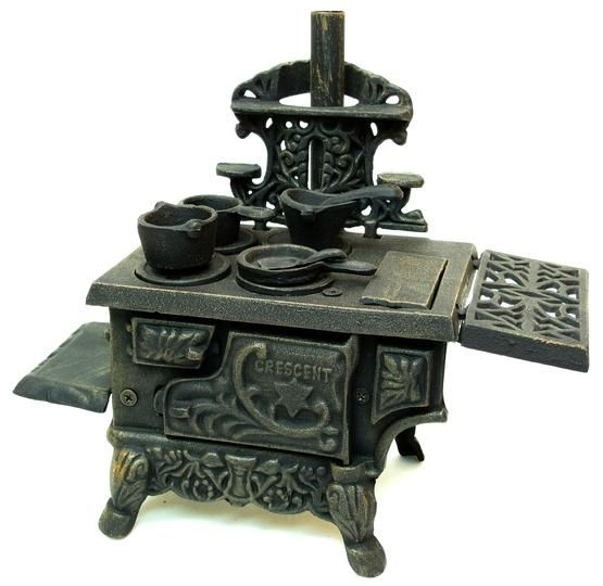 Vintage cast iron toy stove.  I have a little 1960's reproduction stove just like this.  It is so cute!!  I always loved kitchen and cooking toys.