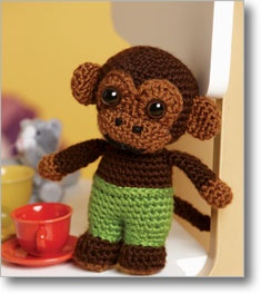 make him out of variegated sock yarn and embroider the eyes - tiny monkey