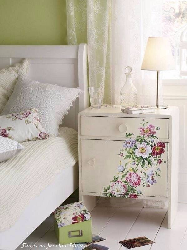 Nightstand decorated with cascading flowers.