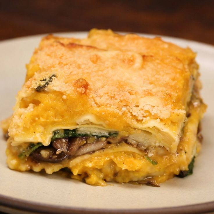 Ingredients: 1 (2 lb) butternut squash, Olive oil, 4 cups prepared Alfredo sauce or cream, Salt and pepper to taste, ½ tsp freshly ground nutmeg, 2 Tbsp shallots, minced, 2 garlic cloves, minced, 2 cups bella mushrooms, sliced, 1 cup pecorino cheese, grated, 1 cup fontina cheese, grated, 1 cup Parmesan cheese, grated, 3 Tbsp sliced fresh sage, 1 ½ lbs 4-cheese ravioli, 1 cup spinach