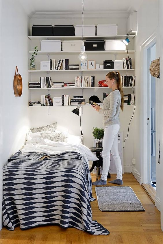 open shelving above the bed is the best solution for such a small bedroom