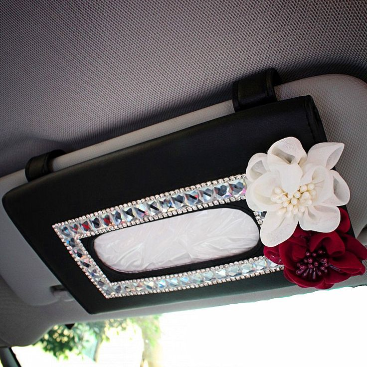 Car Sun Visor Organizer Tissue Bag with Bling Flowers. This tissue holder is a great option for someone who likes to stay neat and be stylish at the same time. We've chosen a color scheme that will go with all car interiors by keeping things simple with a black base, clear rhinestones, a white flower and a single pop of red. Carsoda