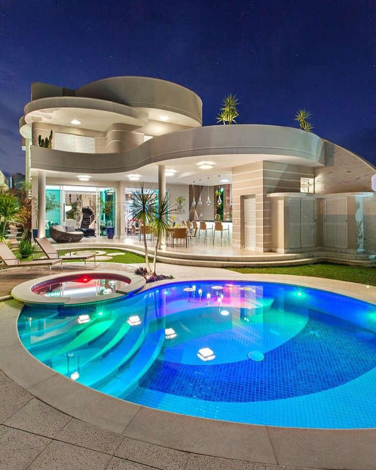 this house uses a curved design this design gives off a crazy fun vibe normally i wouldnt like the design of the house but the pool along with the house