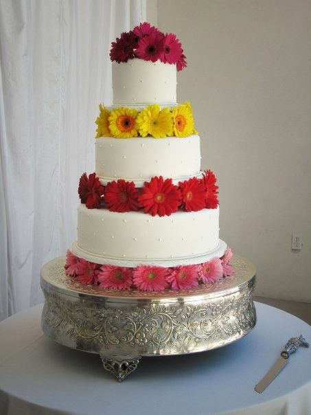 Colorful gerbera daisies on each layer of the bridal cake (flowers by Lee Forrest Design)
