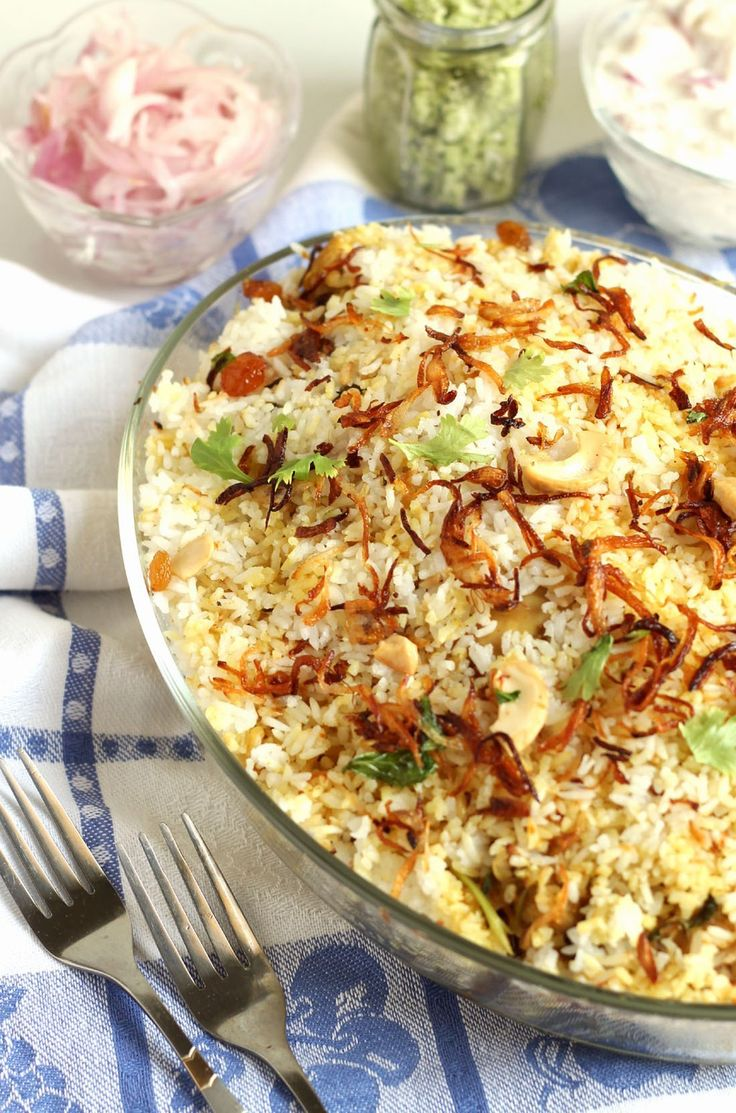 Delicious and flavorful North Kerala style one pot meal recipe with step by step images.Chicken marinated in spices then layered with rice and dum cooked.