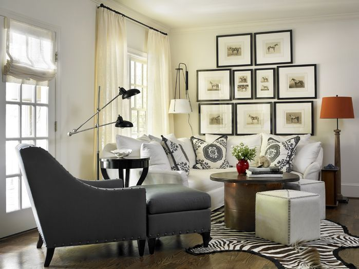 Cozy Small Living Room In The Situated In The Corner Of A Larger Space That  Contains A Small Zebra Print Rug, Grey Chair With Matching Ottoman, ...