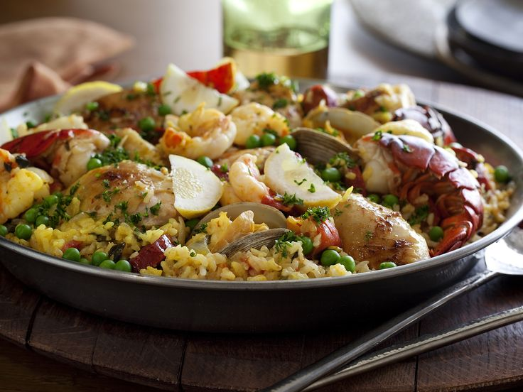 This is one of my favorite recipes ever! Add sea scallops and mussels as well! Makes for a great family dinner or diinner with great friends and a crisp bottle of white wine!    The Ultimate Paella from FoodNetwork.com