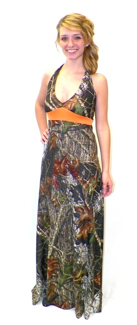 Carrie Anne Camo Formal Dress - $199.99 - This classically styled, elegant camouflage dress works perfectly for a camo bridesmaid dress or a camo prom dress. Similar to our best selling Cadence dress, but with blaze orange trim under the bust. The comfortably cut halter style top ties behind the neck for the perfect fit and is lined in blaze orange so just a touch of blaze shows. Camo Diva Brand. Licensed Mossy Oak product. Made in America.