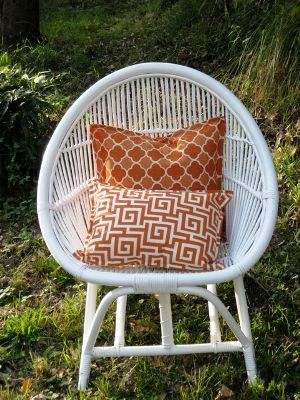 Love the combo of white and orange cushions