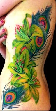 vibrant colored tattoos - A peacock feather and Lilies