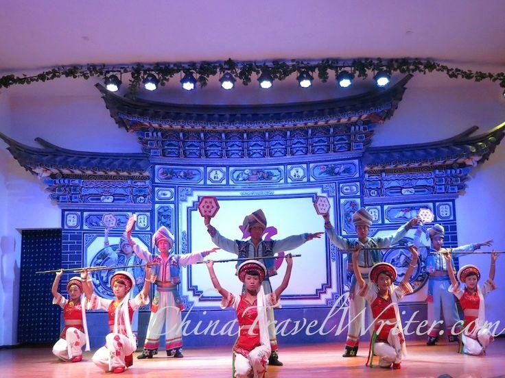 The Dali wedding show begins with dancers raising staffs.