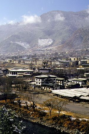 #Thimphu, the capital of Bhutan, lies in a beautiful, wooded valley, sprawling up a hillside on the bank of the Thimphu Chhu River. It is the only world capital without traffic lights. Despite recent development, Thimphu retains its charming, medieval feel thanks to its brightly painted and elaborately decorated facades.