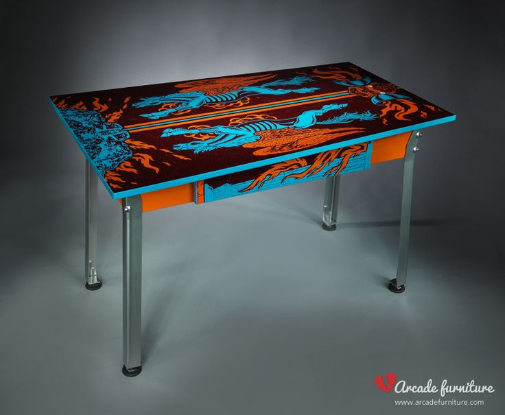 This colorful desk is made from the original cabinet sides of the Earth Wind Fire pinball by Zaccharia, built in 1987. The top of the table is covered with protective glossy clear coating. For further information visit our webpage: www.arcadefurniture.com  or FB page: http://www.facebook.com/pages/Arcade-Furniture/208886032582245