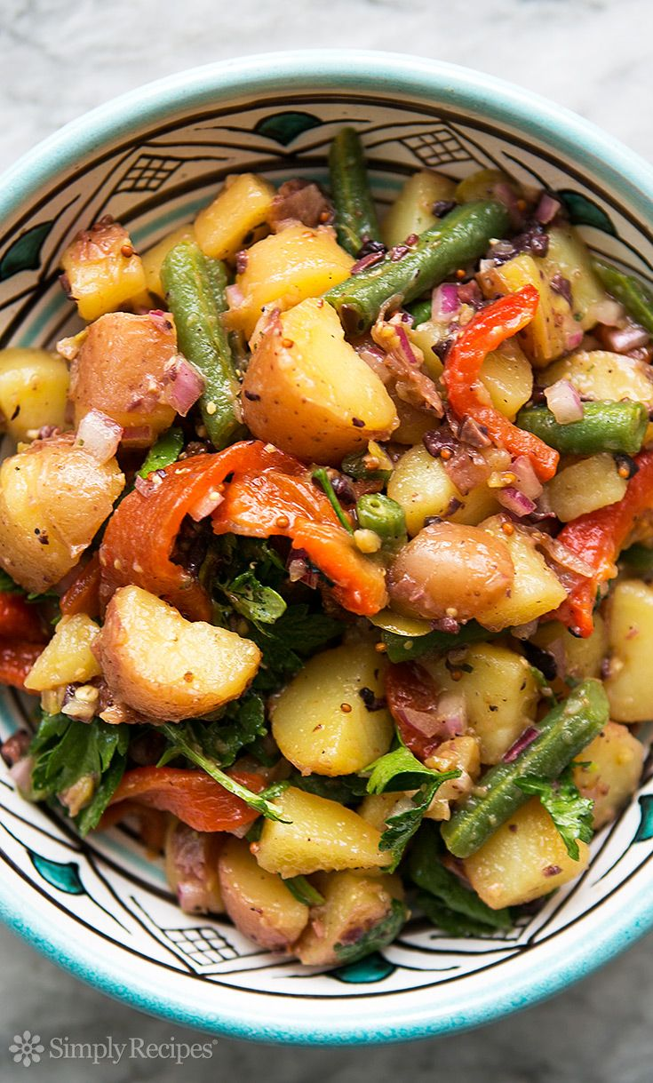 Mediterranean Potato Salad ~ Summery potato salad with new potatoes, green beans, roasted red bell peppers, red onion, olives, parsley, tossed in vinaigrette. ~ SimplyRecipes.com