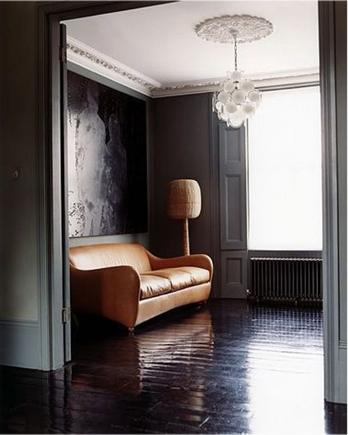 black floor camel sofa dark gray walls white ceiling