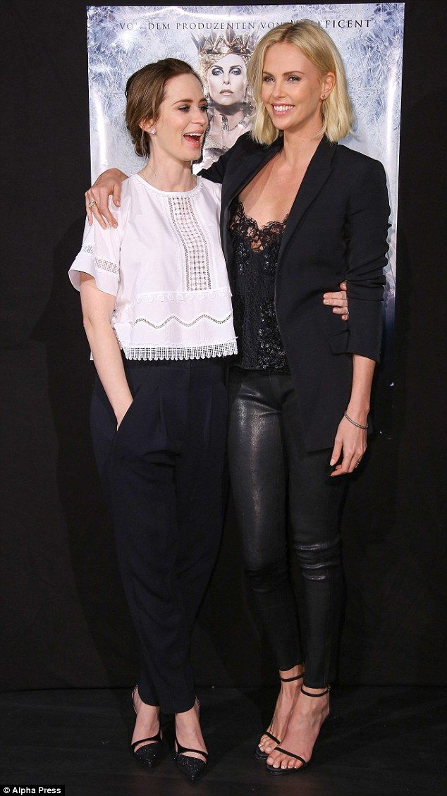 Firm friends: She cosied up alongside her pregnant co-star Emily Blunt once inside the ven...