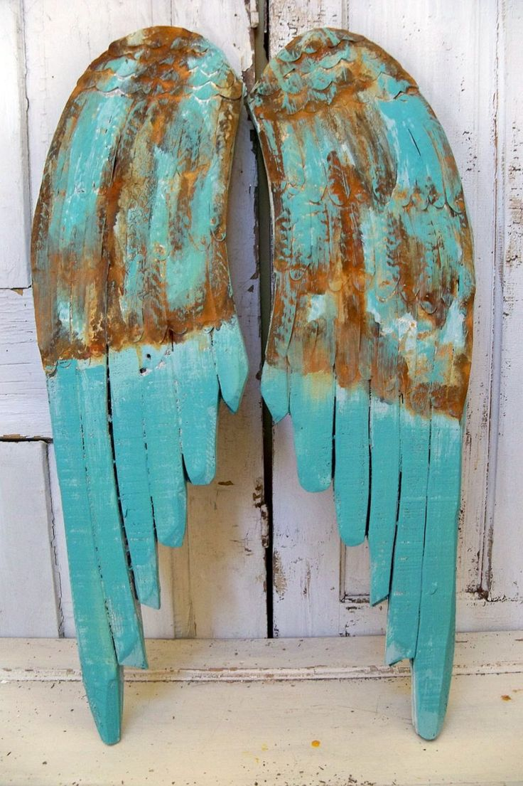 Wooden wings rusty aqua turquoise mix wall sculpture distressed hand carved home decor Anita Spero. $195.00, via Etsy.