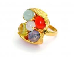 Ring with five stones set in silver/gold.