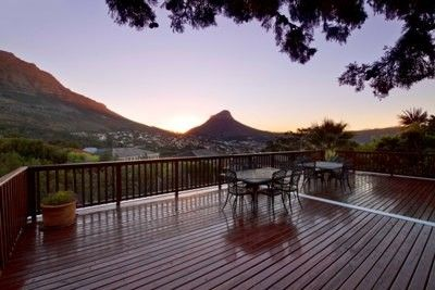 Vredehoek property - This operational guesthouse nestles at the foot of Table Mountain on a sprawling erf of 1063sqm. It is a large 9 bedroom property and has views that will take your breath away. With 2 x double garages, a sparkling swimming pool, stunning decks and a garden that leads onto the mountain, the potential is endless. Can be converted into anything you want. Calls us to view.