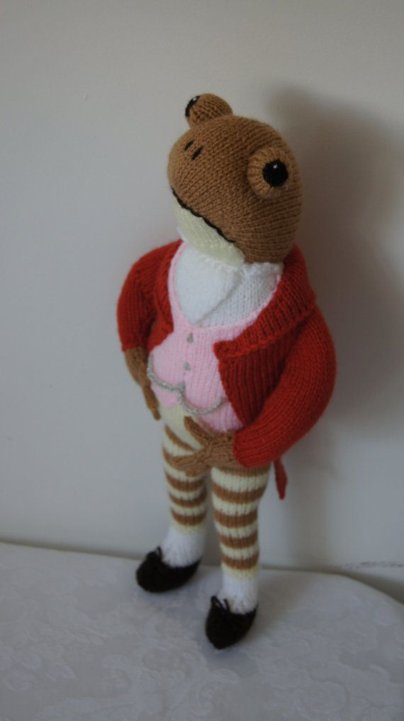 Inspired by Beatrix Potters The Tale of Mr Jeremy Fisher, a hand knitted soft toy designed by Alan Dart and made by Liz, he stands approx 18ins tall and is made entirely from wool so is safe for all ages, he wears his crisp white shirt with cravat and pink waistcoat with silver woolen buttons and silver woolen Albert chain and his smart burnt orange morning coat with tails and striped leggings with dark brown shoes, a very dapper gent indeed. Filled with washable stuffing that conforms to…