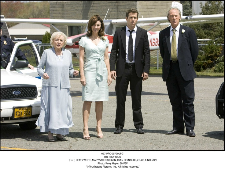 Betty White wearing our carved pendant and freshwater pearl necklace in the movie The Proposal.  www.villagesilversmith.net