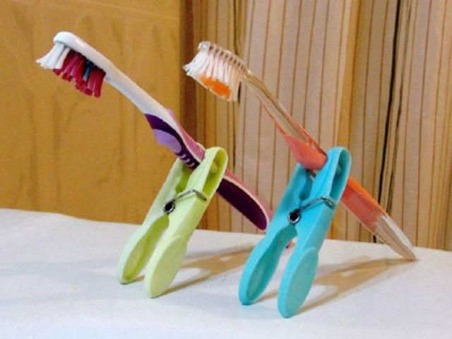 14 Brilliant Pinterest Packing Tips: Make DIY toothbrush holders from clothespins