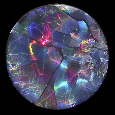 Precious Opal - New South Wales, Australia -  Dimensions: diameter 37mm, thickness 6.5mm -  Accession #: G91.1