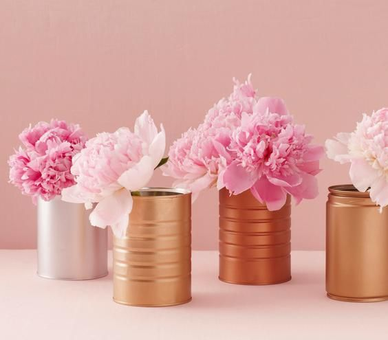 A bunch of pink peonies and a few leftover coffee canisters can transform a tablescape.