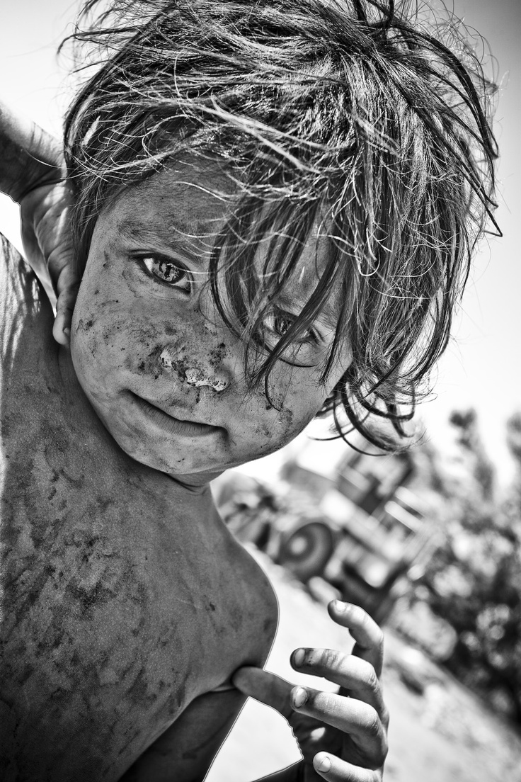 Eyes of Hope  Dreaming of a new life away from this post-apocalyptic war zone. Photo by Eric Kelley.