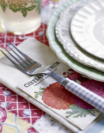 Seed Packets Slipped under Forks at place settings make pretty party favors.