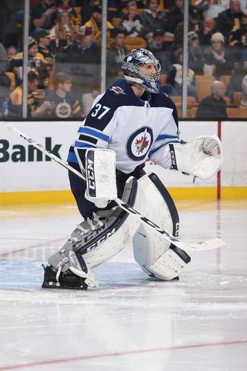 BOSTON, MA - DECEMBER 21: Connor Hellebuyck #37 of the Winnipeg Jets watches the play against the Boston Bruins at the TD Garden on December 21, 2017 in Boston, Massachusetts. (Photo by Steve Babineau/NHLI via Getty Images)