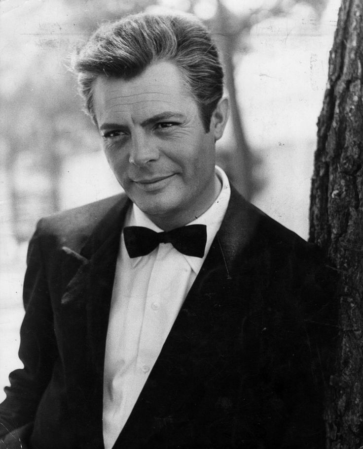 """Marcello Mastroianni (1924-1996), was an Italian actor. Best known for starring roles in the films of Fellini and De Sica. Actor among the most versatile of Italian cinema, he was able to maneuver equally well both in dramatic roles and in the comic ones. With Gassman, Sordi, Tognazzi and Manfredi was one of the """"musketeers"""" of the Italian comedy. He was three times nominated for an Oscar for Best Actor. He obtained on two different occasions the Cannes Film Festival award for Best Actor."""