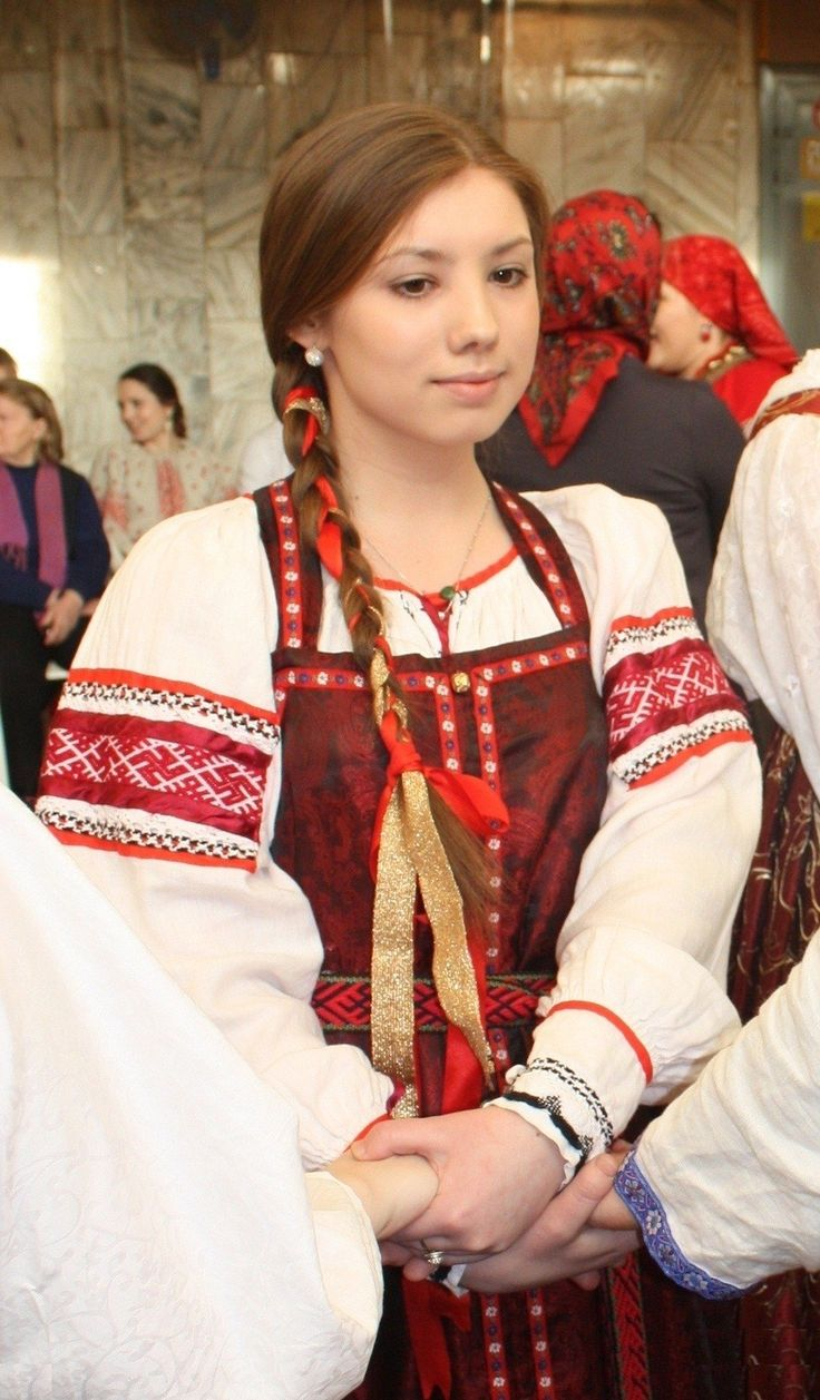Traditional costume of a young girl from Siberia, Russia. Modern work according to the fashion of the 19th century.