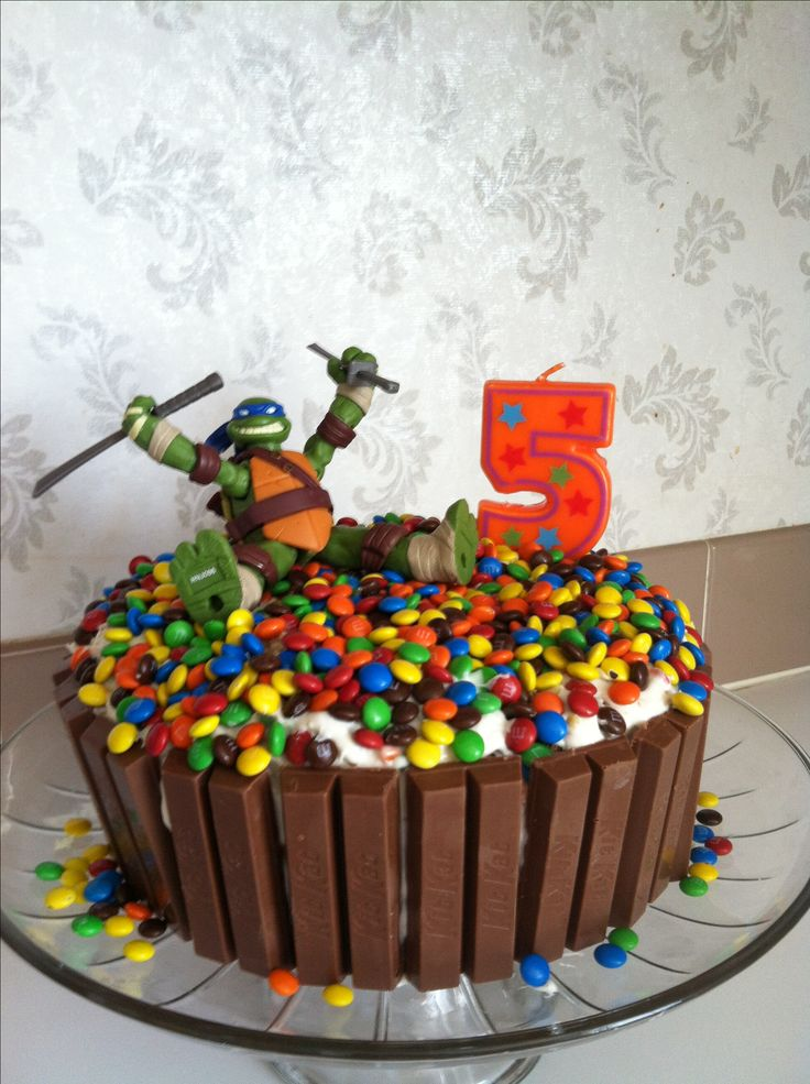 make the same cake just put transformer on top maybe just do red, blue, yellow and black m and m's