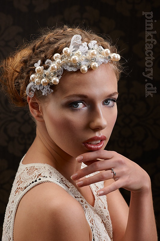 Fantastic hair piece with lace, rhinestones and large pearls.
