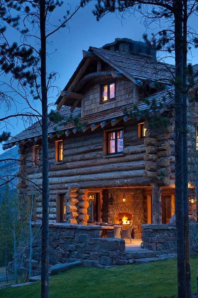 Utterly charming Montana-style cabin evokes warmth and comfort on a cool summer evening.