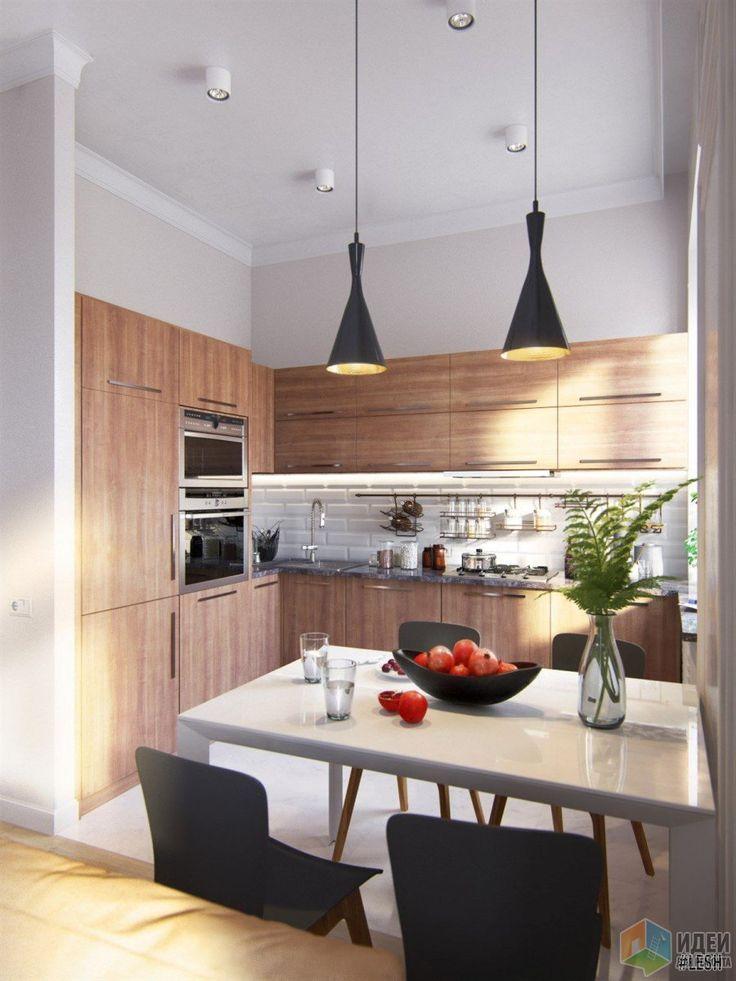 В целом кухня получилась компактной и функциональной. Кухонный фартук и классические подвесные светильники подчеркивают индивидуальность этого дизайна. Другие способы оформления этого проекта и интересные решения дизайнеров смотрите на нашем сайте.
