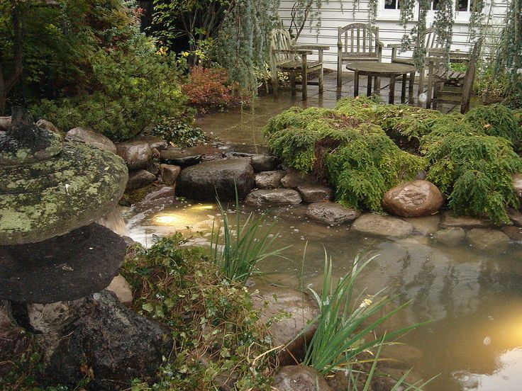 Waterfall Water Feature Ecosystem Water Garden Pond is Repaired, Restored, Remodeled and Installed for many more years of enjoyment for this Rochester NY Backyard. Led Lighting System is on a timer and will turn on and off automatically