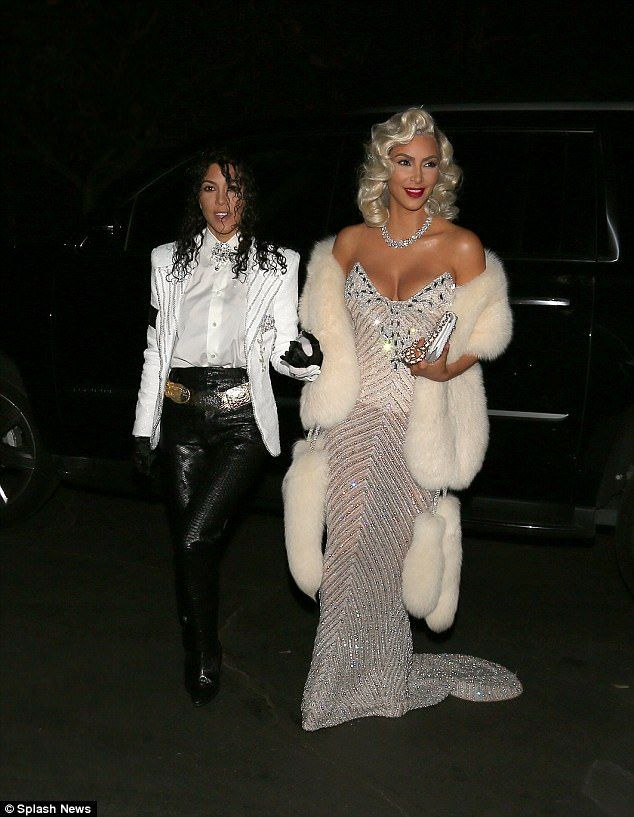 Double trouble! On Saturday Kim Kardashian recruited her sister Kourtney in on the fun as the siblings channeled none other than Michael Jackson and Madonna