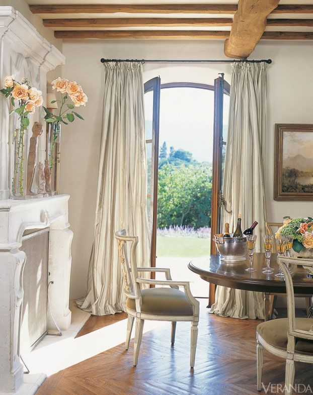 Cottage Chic Dining Room With French Doors Curtains Fireplace Ceiling Beams