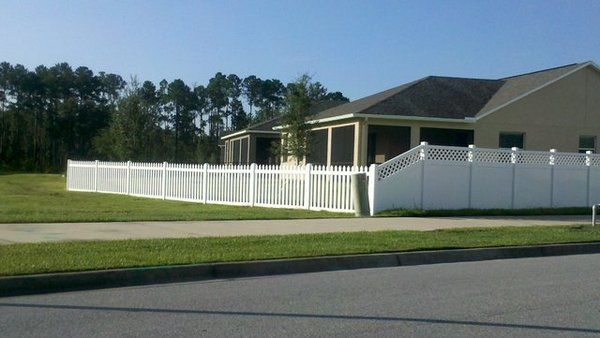 Vinyl Lattice Accent Privacy fence tapered to Vinyl Picket Fence | Yelp how to slope with hill