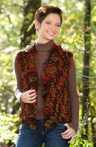 Swing Ruffles Vest - ruffle yarns can make more than the twirly scarves! Free pattern!