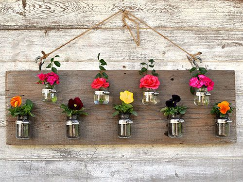 Revamp your gardening this summer: recycle old vegetable containers and turn them into top-notch, planter art.